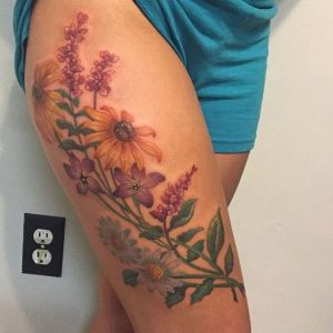 Assorted Flowers Thigh Tattoo