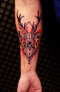 Blue-Eyed Deer with Bloody Background Forearm Tattoo