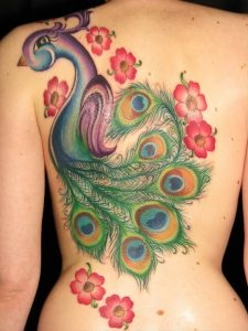 Chic Themed Peacock Back Tattoo