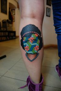 Colorful Abstract Woman Face Calf Tattoo