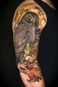 Dark Feathered Owl Perched on Autumn Leaves Arm Sleeve Tattoo