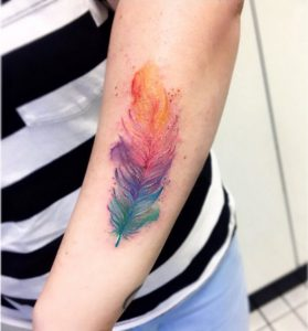 Delicate Feather Forearm Tattoo