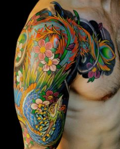 Floral Peacock Arm Tattoo