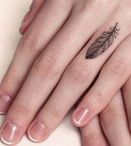 Little Tribal Feather Finger Tattoo