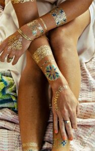 Matching Gold Hand, Arm, and Leg Band Tattoos