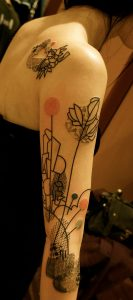 Modern Styled Floral Arm Tattoo