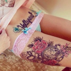 Pink Flower with Clock Thigh Tattoo