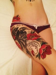 Red Flowers with Bird Thigh Tattoo