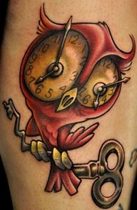 Red Owl with Clock Eyes Arm Tattoo