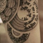 Sanskrit Characters in Circling Pattern Arm Tattoo