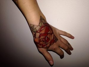 Stained Glass Rose Hand Tattoo