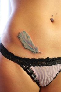 Stunning Feather Belly Tattoo