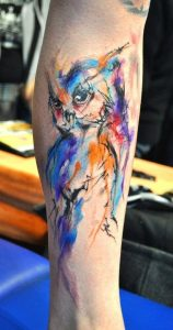 Watercolor Abstract Owl Forearm Tattoo