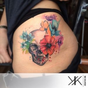 Watercolor Flowers with Skull Thigh Tattoo