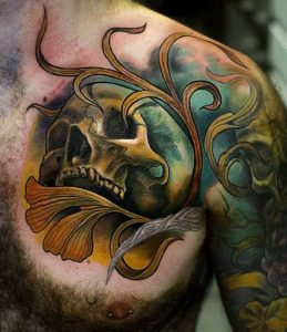 Watercolor Plant and Skull Chest Tattoo