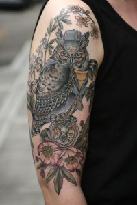 Wise Looking Owl On Twigs Arm Sleeve Tattoo