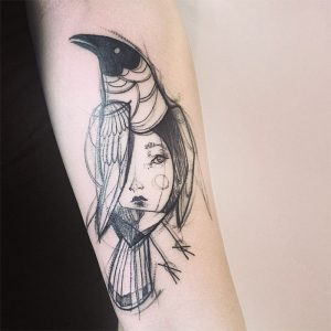 Bird With Lady's Face Arm Tattoo