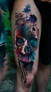 Lovely Watercolor Skull Thigh Tattoo