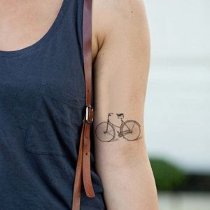 Subtle Bicycle Arm Tattoo