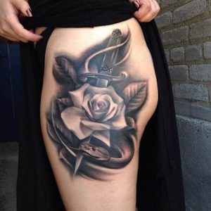 3D Shaded Rose and Dagger Thigh Tattoo