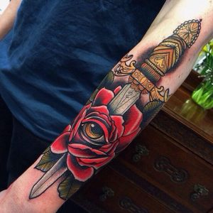 Gold Dagger and Rose with Eye Arm Tattoo