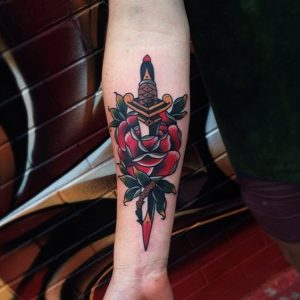 Red Tipped Dagger with Rose Forearm Tattoo