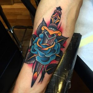 Short Handled Dagger and Blue Rose Forearm Tattoo