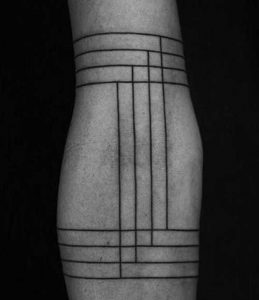 Intersecting Parallel Lines Arm Tattoo