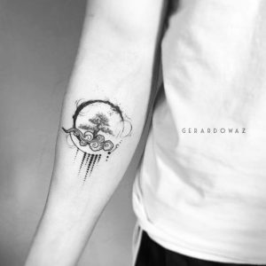 Artistic Spherical Logo of 2 Elements Forearm Tattoo