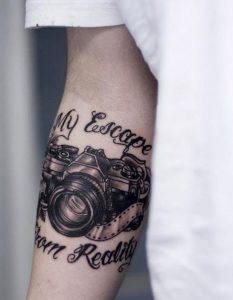 Camera And Quotes Forearm Tattoo