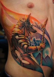 Colored Anubis Holding Staff Side Tattoo