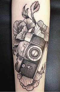 Linework Camera With Peonies Forearm Tattoo