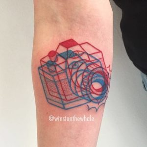 Overlapping Cameras Forearm Tattoo
