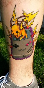 Pikachu Coming Out from a Gameboy Calf Tattoo