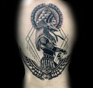 Side View Anubis over the Wings of a Beetle Arm Tattoo
