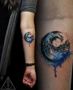 Spherical Symbol of Water with Watercolor Forearm Tattoo