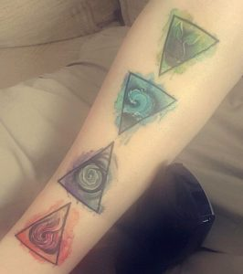 Watercolor Natural Elements in Triangles Forearm Tattoo