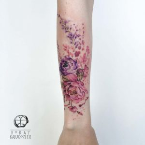 Pink And Purple Floral Arrangement Arm Tattoo