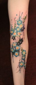 Watercolor Blue Flowers Arm Tattoo
