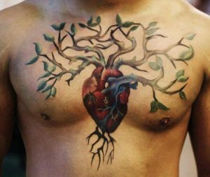 Anatomical Heart With Vibrant Tree Chest Tattoo