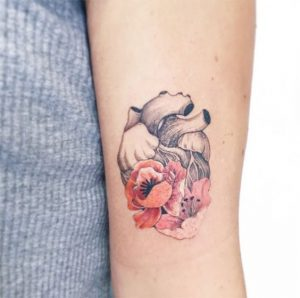 Floral Anatomical Heart Arm Tattoo