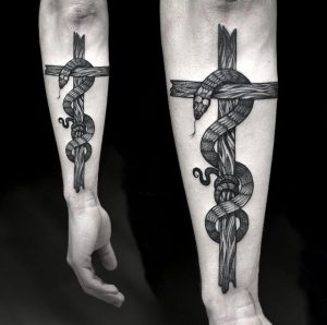 Jaw Dropping Rod Of Asclepius Tattoo