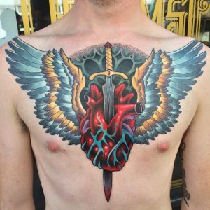 Winged Anatomical Heart Pierced With Dagger Chest Tattoo