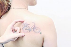 Fine Line Pastel Bicycle Back Tattoo