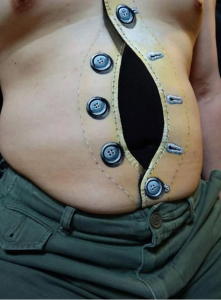 Opened Buttons Belly Tattoo