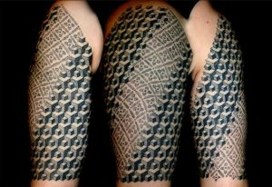 Polynesian and Escher Inspired Illusion Tattoo