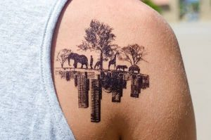Nature And City Scape Back Shoulder Tattoo