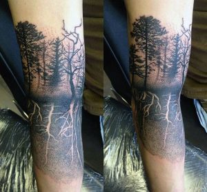 Negative Space Tree Roots Arm Tattoo