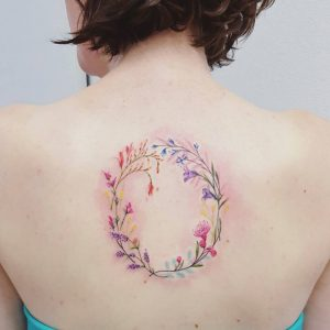 Ring Of Flowers Back Tattoo