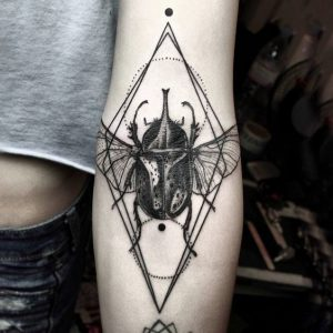 Graphical Beetle Forearm Tattoo